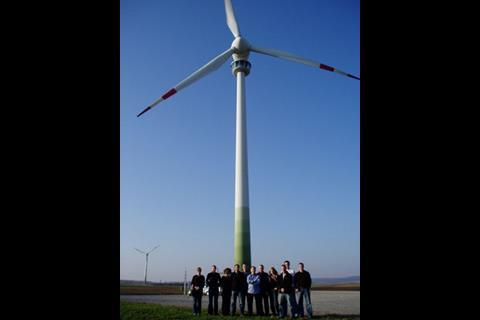 Group shot in front of a wind turbine in Austria